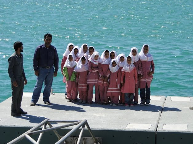 Kids of Persian Gulf and their teachers aboard the floating concrete deck