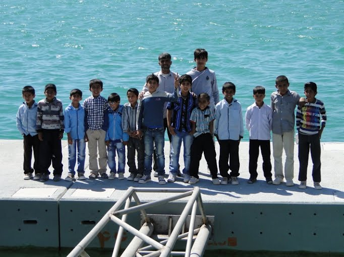 Future fishermen of Persian Gulf inaugurate their new concrete pontoon deck