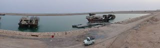 An overall view of the under-construction port in Chiruyeh and Parsian floating concrete fishery deck in the middle of the man-made basin