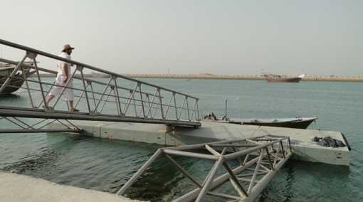 A floating concrete fishery pier equipped with stainless steel gangway and truss arms, Chirouyeh, Persian Gulf